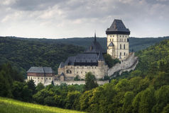 Karlstein castle on cloudy sky stock images