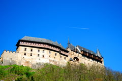 Karlstejn Castle. Panorama of the Karlstejn Castle over blue sky during the summer day Stock Image