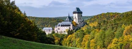 Karlstejn Castle in colorful autumn. Panoramic view of medieval Karlstejn Castle in colorful autumn season. Czechia Royalty Free Stock Photos