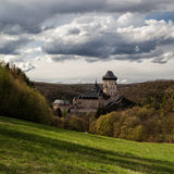 Karlstejn castle in the forest Royalty Free Stock Photos