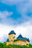 Karlstejn castle on green hill, Prague. Czech Republic Royalty Free Stock Photography