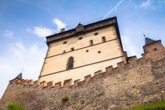 Karlstejn castle tower under blue sky Stock Images