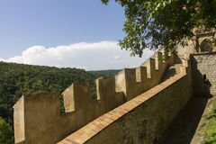 Karlštejn Castle defensive wall and surrounding nature Royalty Free Stock Images