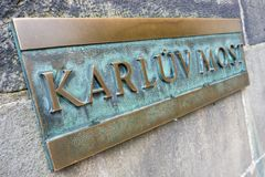 Karluv most bridge ensign in Prague. Karluv most bronze ensign on wall of Charles bridge over Moldova river in Prague Royalty Free Stock Photography