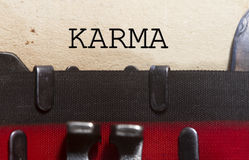 Karma belief. Typed on an old vintage paper with od typewriter font Royalty Free Stock Photography