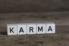 Karma, in kubussen wordt geschreven die royalty-vrije stock foto's