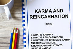 Karma and Reincarnation. Concept- -with topics on a cover sheet of a lecture royalty free stock image