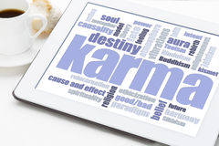 Karma word cloud on tablet Stock Images