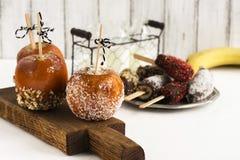 Karmelizujący jabłka - Halloween desset dodatkowej jesień karciany format Zdjęcie Royalty Free