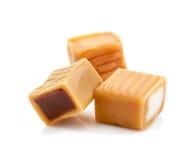 Karmelu cukierek na bielu zdjęcia royalty free