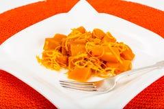 Karmelu deser bania z pomarańczowym zapałem Zdjęcia Royalty Free
