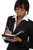 Karmiący bizneswoman Zdjęcia Stock