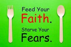 Karmi Twój wiarę zdjęcia stock