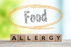 Karmowej alergii znak na stole zdjęcia stock