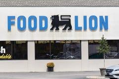 Karmowy lwa wejście, znak i Obrazy Royalty Free