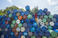 A worker organizes barrels at Karnafuli Rivers Sadarghat areas, Chittagong, Bangladesh. Karnafuli River Sadarghat areas, Chittagong, Bagladesh. Chittagong is Royalty Free Stock Photos