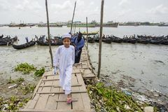 A boy and his mother. Karnafuli River Sadarghat areas, Chittagong, Bagladesh. Chittagong is situated on the banks of the Karnaphuli River between the Chittagong Stock Images
