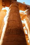 Karnak Temple Complex in Luxor. polychromed columns with carvings of the pharaoh and his wife royalty free stock image