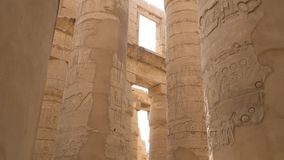 Karnak Temple in Luxor, Egypt. The Karnak Temple Complex, commonly known as Karnak, from Arabic Khurnak meaning fortified village , comprises a vast mix of stock video footage