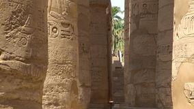 Karnak Temple in Luxor, Egypt. The Karnak Temple Complex, commonly known as Karnak, from Arabic Khurnak meaning fortified village , comprises a vast mix of stock footage