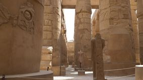 Karnak Temple in Luxor, Egypt. The Karnak Temple Complex, commonly known as Karnak, from Arabic Khurnak meaning fortified village , comprises a vast mix of stock video