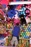 Karnawałowy ballon gry pracownik Fotografia Royalty Free