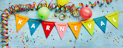 Karneval - Carnival - festive party background. Karneval - Carnival - themed festive party banner background with triangular rainbow colored bunting and stock photos