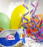 Karnevalsschablonen-Maskeradehintergrund Stockfotos