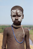 Karo, Ethiopia, Africa. TURMI, ETHIOPIA - NOVEMBER 19, 2014: Karo Boy with traditional paintings on November 19, 2014 in Turmi, Ethiopia Royalty Free Stock Photo
