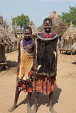 Karo, Ethiopia, Africa. TURMI, ETHIOPIA - NOVEMBER 19, 2014: Karo children with traditional clothings and necklace on November 19, 2014 in Turmi, Ethiopia Royalty Free Stock Image