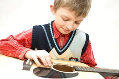 Karolek with guitar Royalty Free Stock Photos