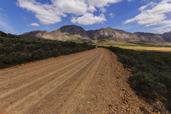 Karoo gravel road blue sky Royalty Free Stock Images