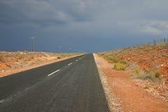 Karoo road. Into thunder storm Stock Image