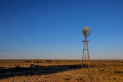 Karoo South Africa landscape with a windmill. Karoo natural region Northern Cape Province South Africa landscape with blue sky, a windmill and wide open spaces stock image