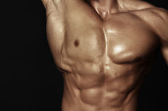Karosserie des muskulösen Mannes Lizenzfreies Stockfoto