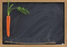 Karotte, Steuerknüppel und Tafel - Schulebeweggrund Lizenzfreie Stockfotografie