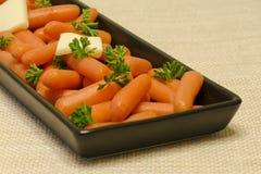 Karotten mit Butter Lizenzfreie Stockfotografie