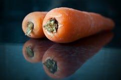 Karotten und Reflexionen lizenzfreie stockfotografie