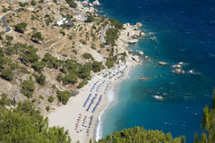 Karpathos - Apella beach in september. The beach is coil up in a picturesque cove and has fine white sand and blue clean sea - Dodecanese Islands, Greece Royalty Free Stock Image