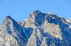 Karpatische bergen, Bucegi met Caraiman-Piek, wolken, sneeuw Royalty-vrije Stock Foto