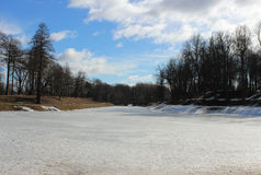 Karpin pond, covered with melting ice in spring Gatchina Park. Stock Photo