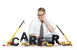 Karriere beginnen oben: Geschäftsmanngebäude Karrierewort. Stockfotografie