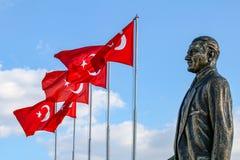 Karsiyaka / Bostanli / Izmir / Turkey, Mustafa Kemal Ataturk sculpture and Turkish flag. Karsiyaka / Bostanli / Izmir / Turkey, Mustafa Kemal Ataturk sculpture stock images