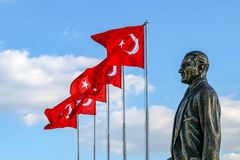 Karsiyaka / Bostanli / Izmir / Turkey, Mustafa Kemal Ataturk sculpture and Turkish flag. Karsiyaka / Bostanli / Izmir / Turkey, Mustafa Kemal Ataturk sculpture stock image