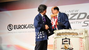 Karsono & Masahiro shaking hands at CX-5 launch Royalty Free Stock Photo