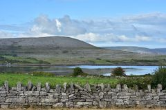 Karst landscape in western Ireland. Karst landscape of Burren Plateau around Bell Harbour in western Ireland stock images