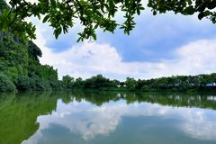 Karst lava landform and lake in Zhaoqing, Guangdong, China. Hill in Karst lava landform and lake view in Zhaoqing, Guangdong province, South of China Royalty Free Stock Photography
