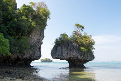Karst limestone shore rocks in Thailand Stock Photo