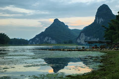 Karst mountains reflected in Li river at sunset Royalty Free Stock Photography