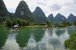 Karst mountains reflected in Yulong river Royalty Free Stock Photo